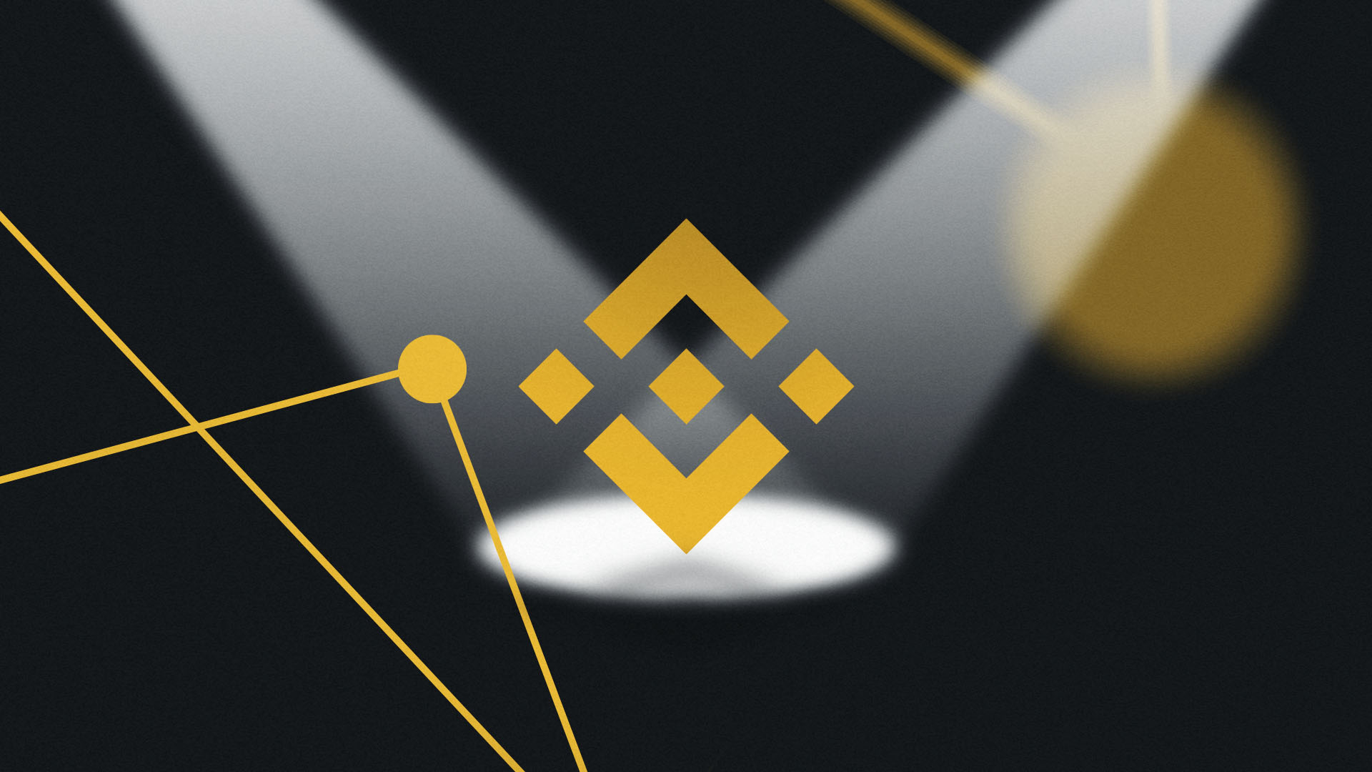 Binance logo in spotlight on black background because its getting hunted over money laundering concerns.
